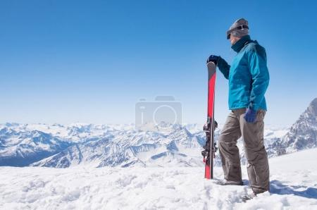 Man with ski on mountain top