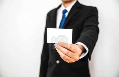 Business man hold white name card paper on hand with isolated white background