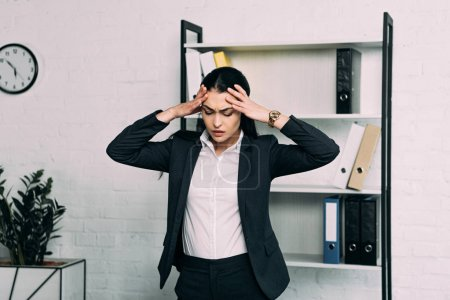 Photo for Portrait of stressed businesswoman standing in office - Royalty Free Image