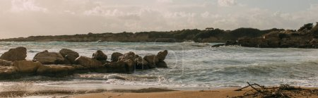 panoramic shot of rocks near mediterranean sea