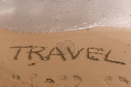 Photo for Summer beach with travel lettering on sand near sea - Royalty Free Image