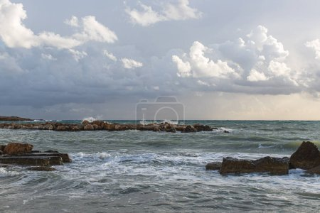 Photo for Rocks near mediterranean sea against sky with clouds - Royalty Free Image