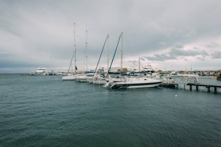 Photo for White yachts in mediterranean sea against sky with clouds - Royalty Free Image