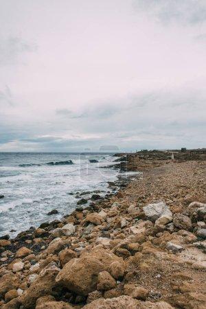 tranquil coastline with stones near mediterranean sea