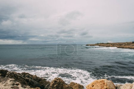 Photo for Coastline with rocks near mediterranean sea against sky with clouds - Royalty Free Image