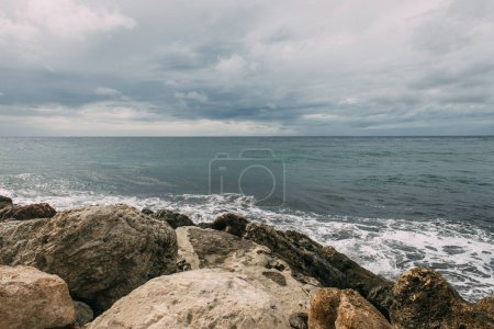 Photo for Mediterranean sea near rocks against sky with clouds - Royalty Free Image
