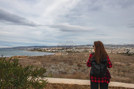 Photo for Back view of traveler with backpack near plants and mediterranean sea - Royalty Free Image