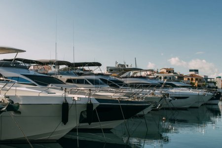 Photo for Sunshine on docked modern yachts in mediterranean sea - Royalty Free Image