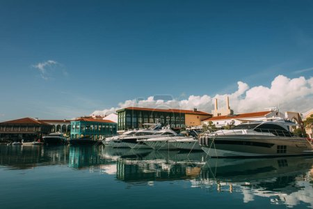 Photo for Sunshine on docked yachts and buildings in mediterranean sea - Royalty Free Image