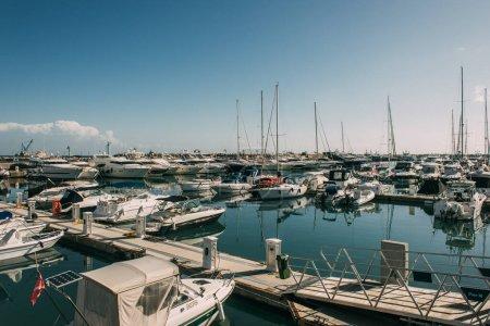 sunshine on docked yachts in port of mediterranean sea