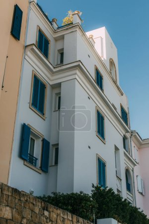 Photo for Low angle view of modern house against blue sky - Royalty Free Image