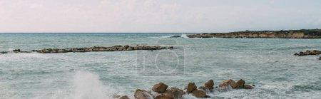 panoramic shot of rocks near mediterranean sea against sky