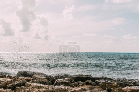 Photo for Rocks near mediterranean sea against blue sky with clouds - Royalty Free Image