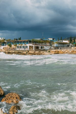 Photo for Building near mediterranean sea against cloudy sky in cyprus - Royalty Free Image