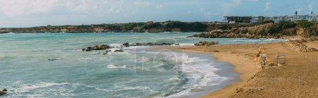 panoramic shot of coastline and sandy beach near mediterranean sea