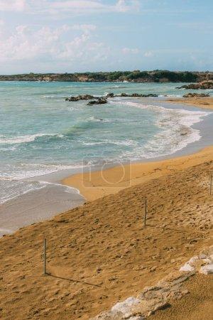 sandy beach near mediterranean sea against blue sky