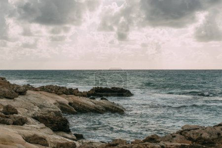 Photo for Coastline near mediterranean sea against grey sky with clouds - Royalty Free Image