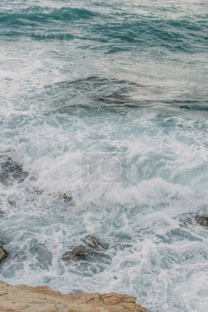 Photo for White foam in blue water of mediterranean sea - Royalty Free Image