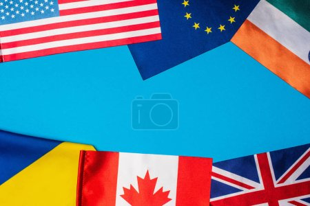 Top view of flags of countries on blue background