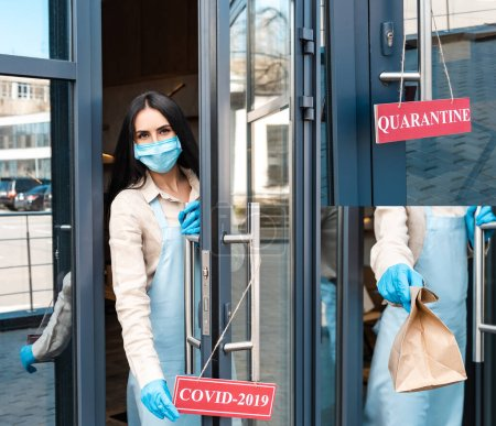 Photo for Collage of cafe owner in medical mask opening door with card with covid-2019 and quarantine lettering and showing paper bag - Royalty Free Image