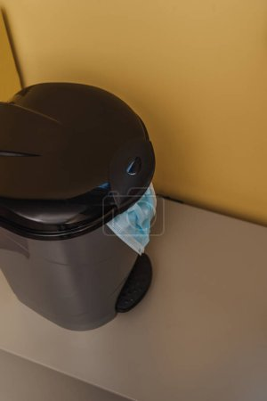 medical mask in trash can, end of quarantine concept