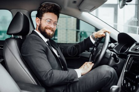 Photo for Handsome young businessman driving car, selective focus - Royalty Free Image