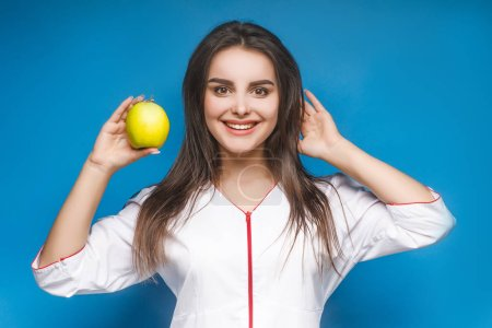 Photo for Portrait of young medical assistant on blue background - Royalty Free Image