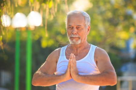 Man Shows Yoga Pose in Park