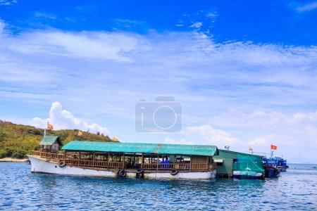 Tourist Motorboat at Moorage by Coast