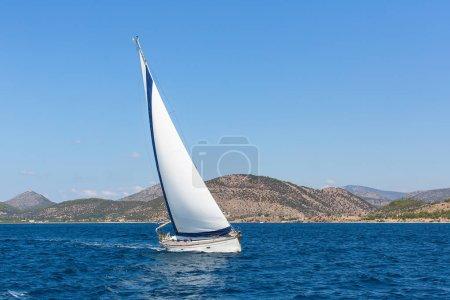 Sailboat participate in sailing regatta