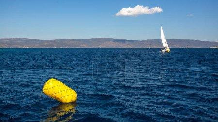 Finish line buoy at sailing yacht