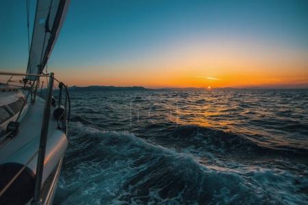 Sailing yacht glides through the waves