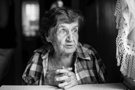 Black and white portrait of elderly woman