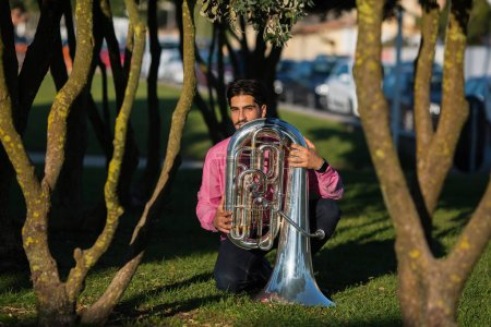 Musician with the tuba on the grass
