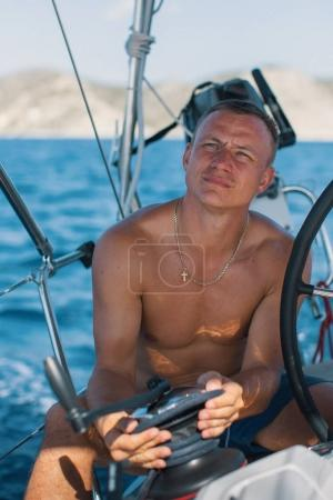Young man at the helm