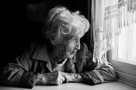 elderly woman looks