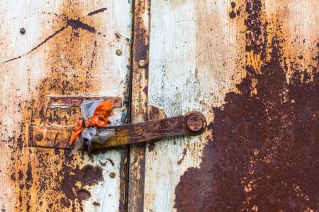 door with peeling paint.
