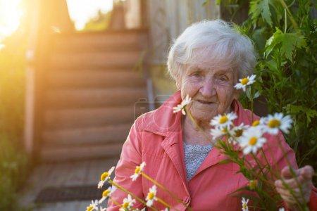 Elderly woman near village house