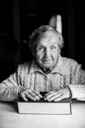 Elderly woman sitting with a book