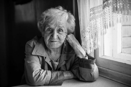 elderly woman sitting in the house.