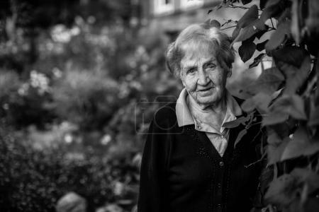 elderly woman in the garden. Black and white portrait.