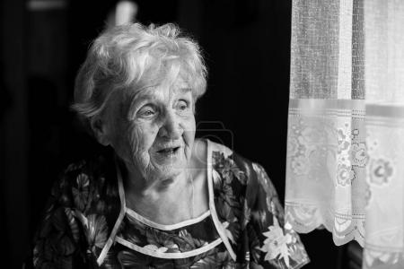 Black and white portrait of an elderly lady.