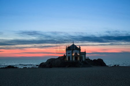 Night view of Chapel Senhor da Pedra at Miramar Beach, near Porto, Portugal.