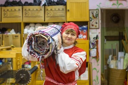 VAZHINY, RUSSIA - DEC 21, 2017: Weaver while working in the Textile Studio of decorative art (Tekstilnaya Plastika) at municipal budgetary institution of culture.