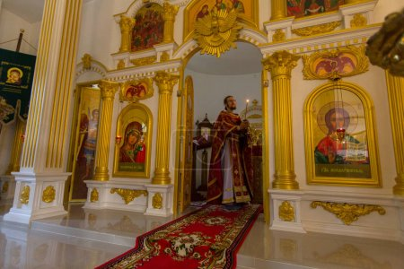 KOH CHANG, THAILAND - FEB 28, 2018: During the Sunday service in Russian Orthodox Church. There are currently 10 Orthodox parishes in Thailand, Orthodoxy is practiced by 0.002% of population.