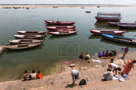 VARANASI, INDIA - MAR 14, 2018: On the banks of the Holy Ganga river. Varanasi is most important pilgrimage sites in India, one of the 7 sacred cities of Hinduism, a Holy city for Buddhists and Jains.