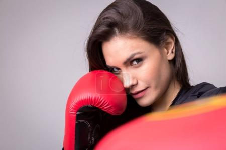Beautiful woman with boxing gloves