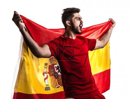 excited male fan holding national flag of Spain isolated on white background