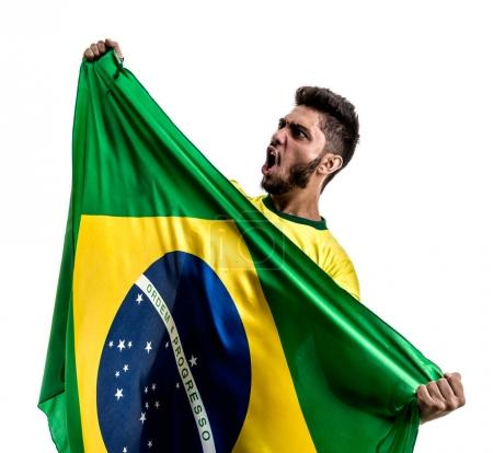 excited male fan holding national flag of Brazil isolated on white background