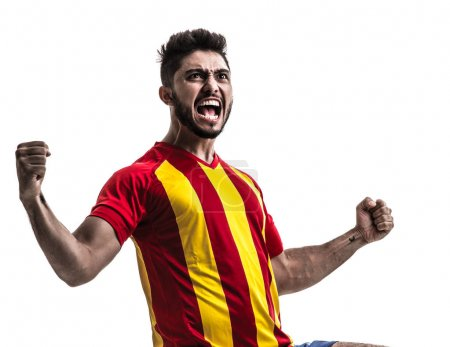excited sportsman in red and yellow uniform on white background. Isolated view of cheerful male fan